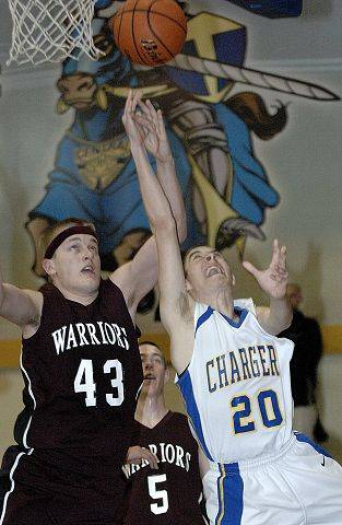 Aurora Central's Matt Czerak goes up for a shot past Wheaton Academy's Luke Johnson in the fourth quarter.