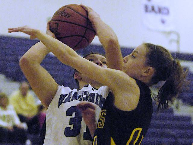 Hampshire's Alex Dumoulin is fouled by Richmond's Erin Thomas Tuesday in Hampshire.