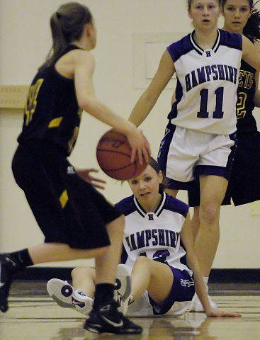 Hampshire's Jessie Van Dorin falls as she guards Richmond's Erin Thomas Tuesday in Hampshire.