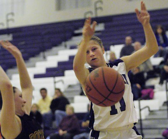Hampshire's Michelle Dumoulin loses the ball as she is fouled by Richmond's Lauren Smith Tuesday in Hampshire.