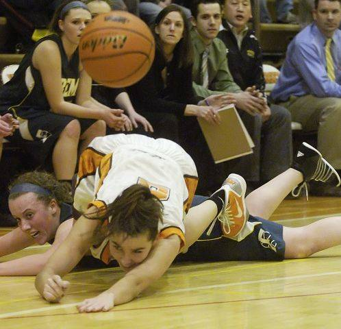 Hersey's Jen Hall, front, and Fremd's Sarah Power hit the floor as they chase a loose ball.