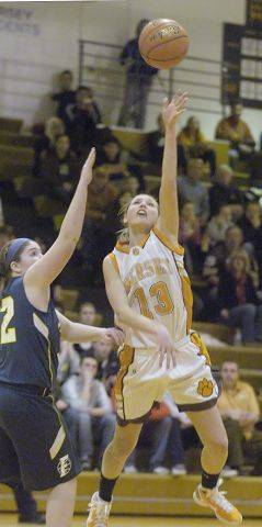 Hersey's Stefanie Mueller shoots in front of Fremd's Megan Horn during Wednesday's Mid Suburban League title game.