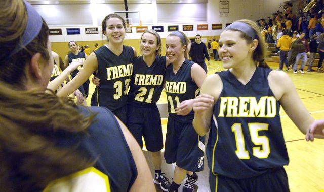 Left to right, Fremd's Megan Gray, Ashley McConnell, Sarah Power and Jaimie Groot celebrate their win over Hersey during Wednesday's Mid Suburban League title game.