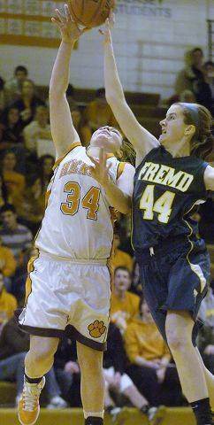 Fremd's Jessi Wiedemann blocks a shot by Hersey's Eileen Zydek during Wednesday's Mid Suburban League title game.