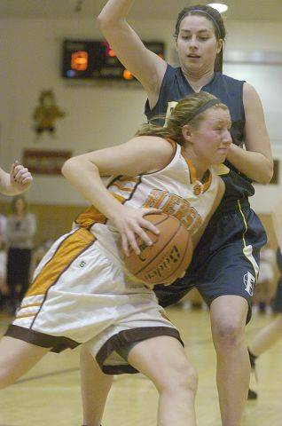 Hersey's Megan Rogowski drives on Fremd's Megan Gray during Wednesday's Mid Suburban League title game.
