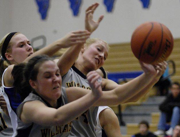 Neuqua Valley's Megan Doody and Alexa Wilde, right, and St. Charles North's Megan Booe claw for a loose ball.