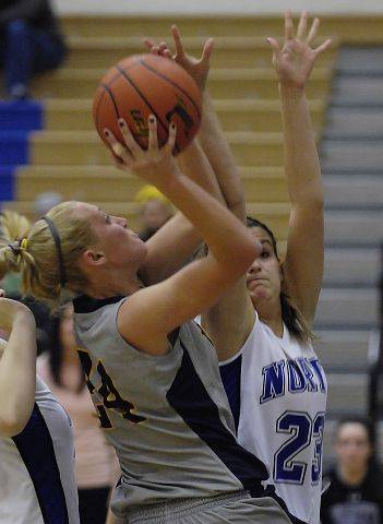 Neuqua Valley's Alexa Wilde charges past the defense of St. Charles North's Leah Horton.