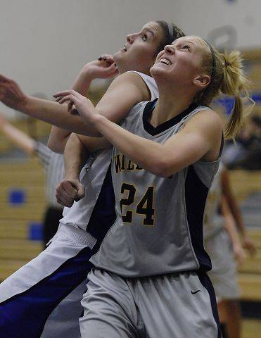 Neuqua Valley's Alexa Wilde and St. Charles North's Leah Horton position for a rebound.