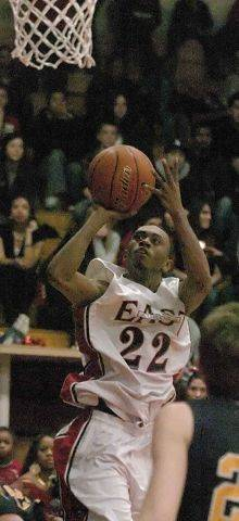 Ryan Boatright of East Aurora puts up a shot against Neuqua Valley.
