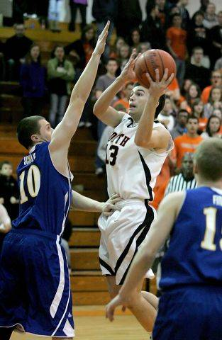 Kevin Bridges of Wheaton Warrenville South goes over Jeff Schalk of Wheaton North for a basket.