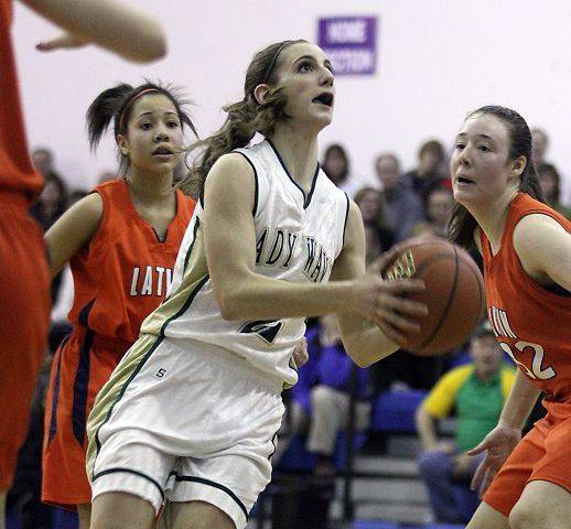 Rena Ranallo of St. Edward drives to the hoop against Latin School Monday during the Green Wave's 54-24 win in the Class 2A Westminster Christian sectional semifinals.
