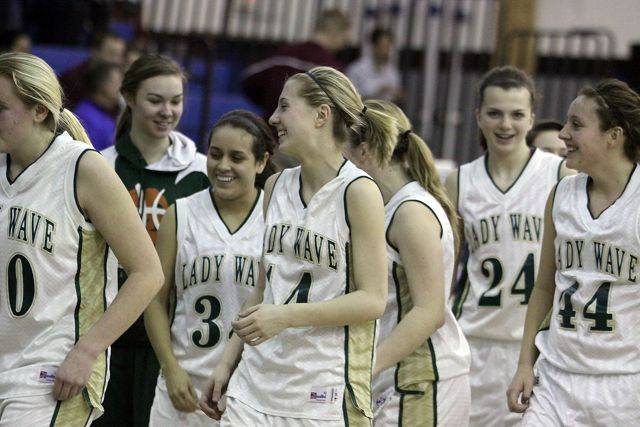 St. Edward players congratulate each other after a sectional semifinal victory over the Latin School at Westminster Christian in Elgin on Monday night.
