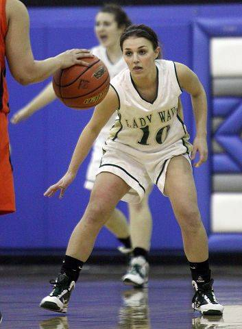 Callie Johnson of St. Edward plays defense against of Latin School at Westminster Christian in Elgin on Monday night.