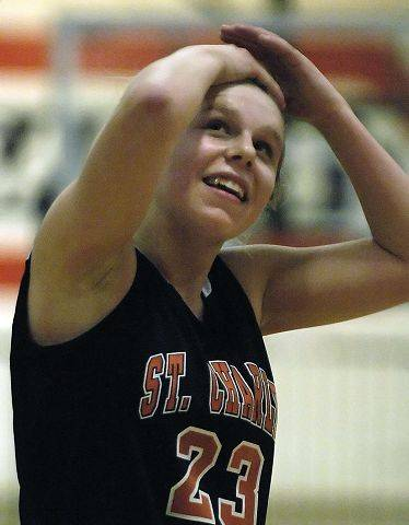 St. Charles East's Amanda Hilton reacts after a foul late in the first half.