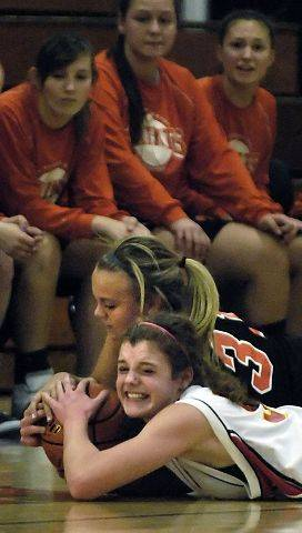 Batavia's Katie Ryan and St. Charles East's Morgan Vyzral jump on a loose ball.