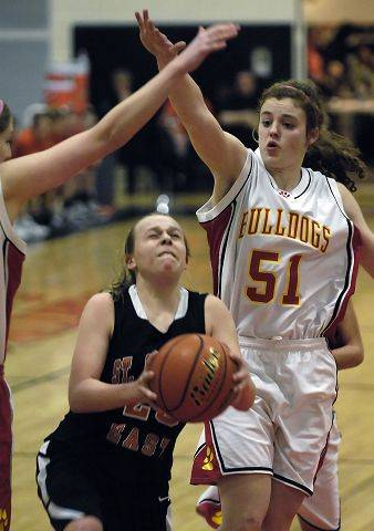 Batavia's Katie Ryan and Maddie Sychta, left, defend against St. Charles East's Amanda Hilton.
