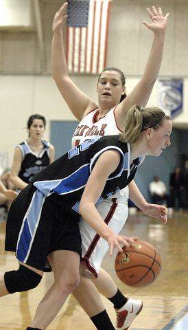 Rosary's Breann Maryanski circles around Yorkville's Elizabeth Swe (cq) in regional game on Tuesday, February 15.