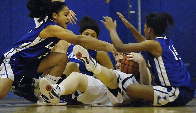 Cary-Grove's Johanna Geegan is swarmed by Larkin's Torie Patterson, Paris Patterson, and Taylor Lindsy in the Dundee-Crown regional semifinal Tuesday.