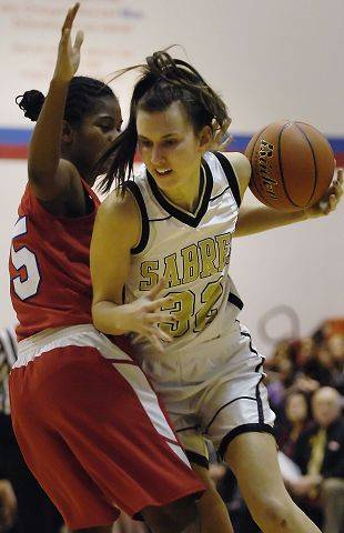 Streamwood's Michelle Tomczak drives past Dundee-Crown's Diamond Williams Tuesday in the Dundee-Crown regional semifinal.