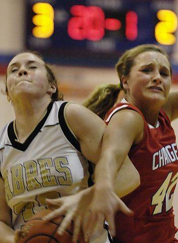 Dundee-Crown's Alexis Holm fouls Streamwood's Emma Schmidt Tuesday in the Dundee-Crown regional semifinal.