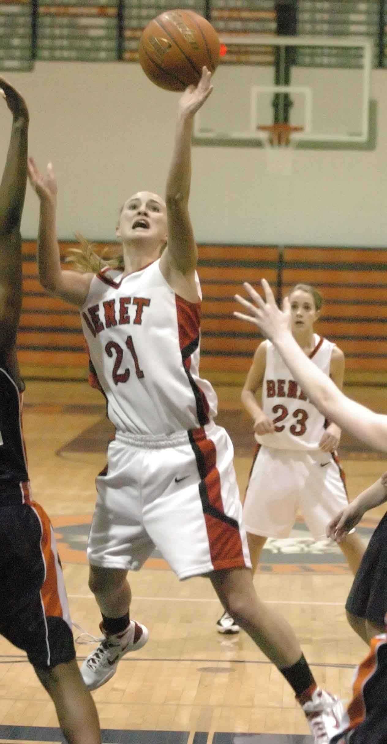 Sidney Prasse of Benet puts up a shot against Naperville North.