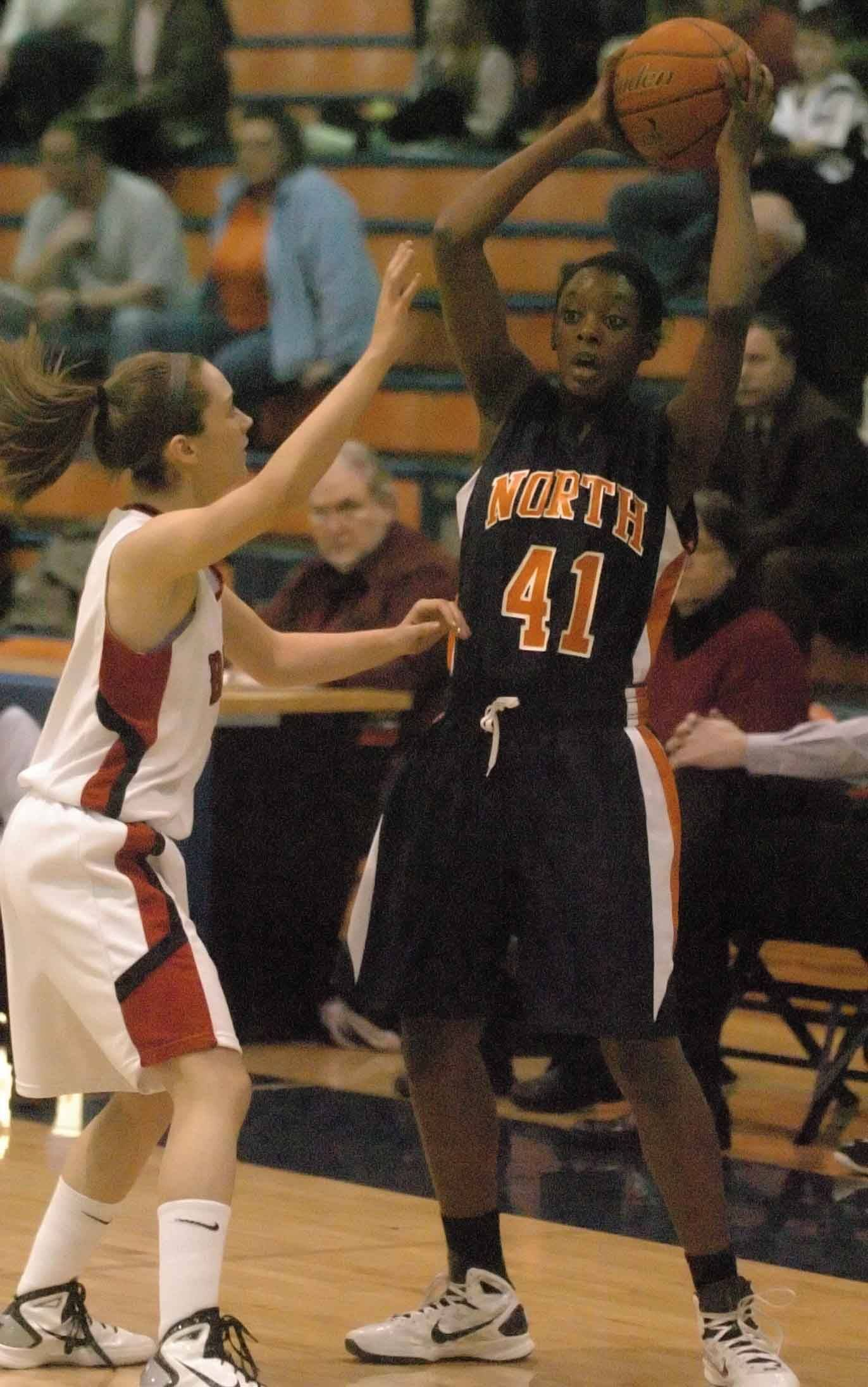 Bukky Adesanya of Naperville North looks to pass against Benet.