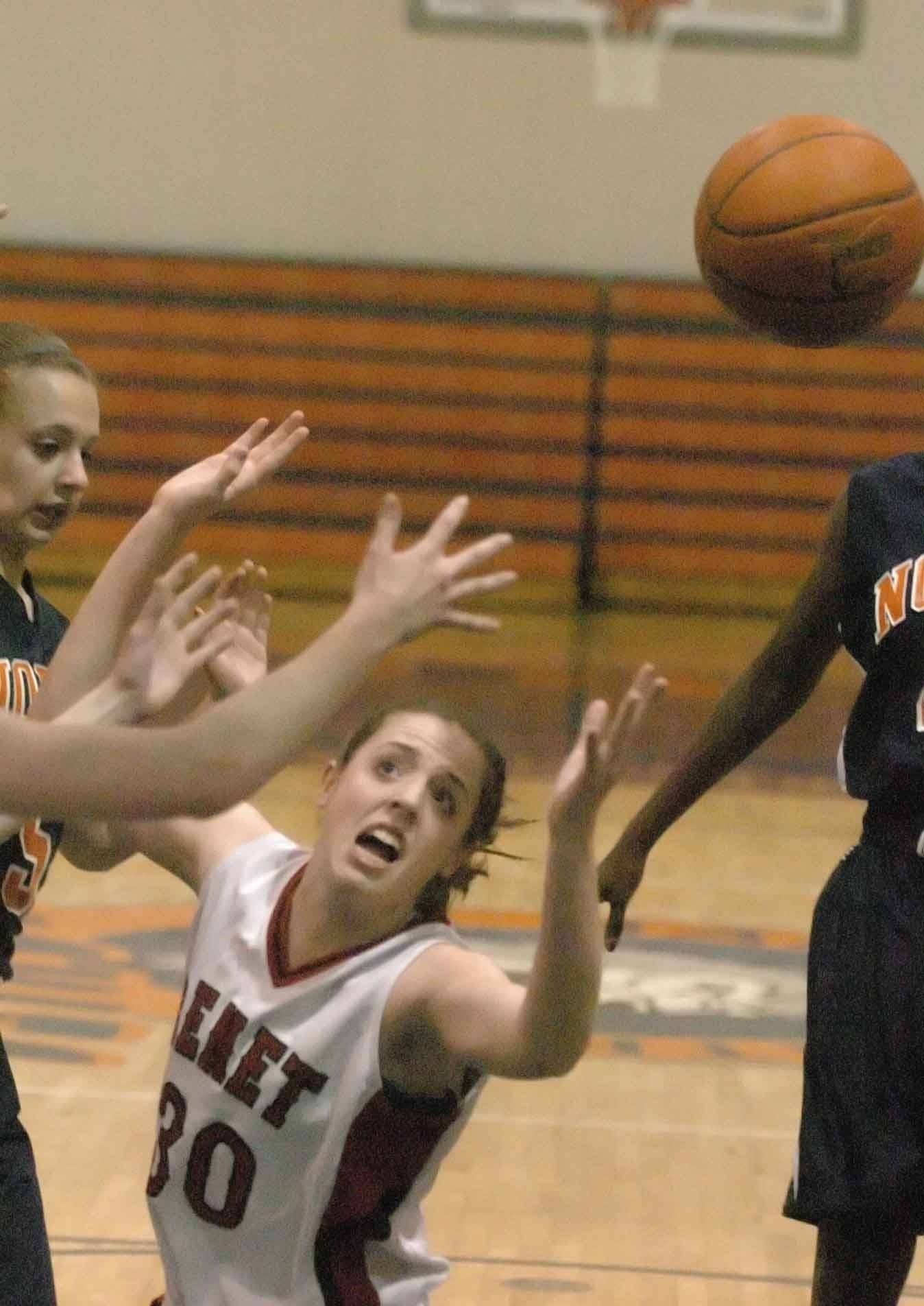 Ashley Veselik of Benet reaches for a rebound against Naperville North.