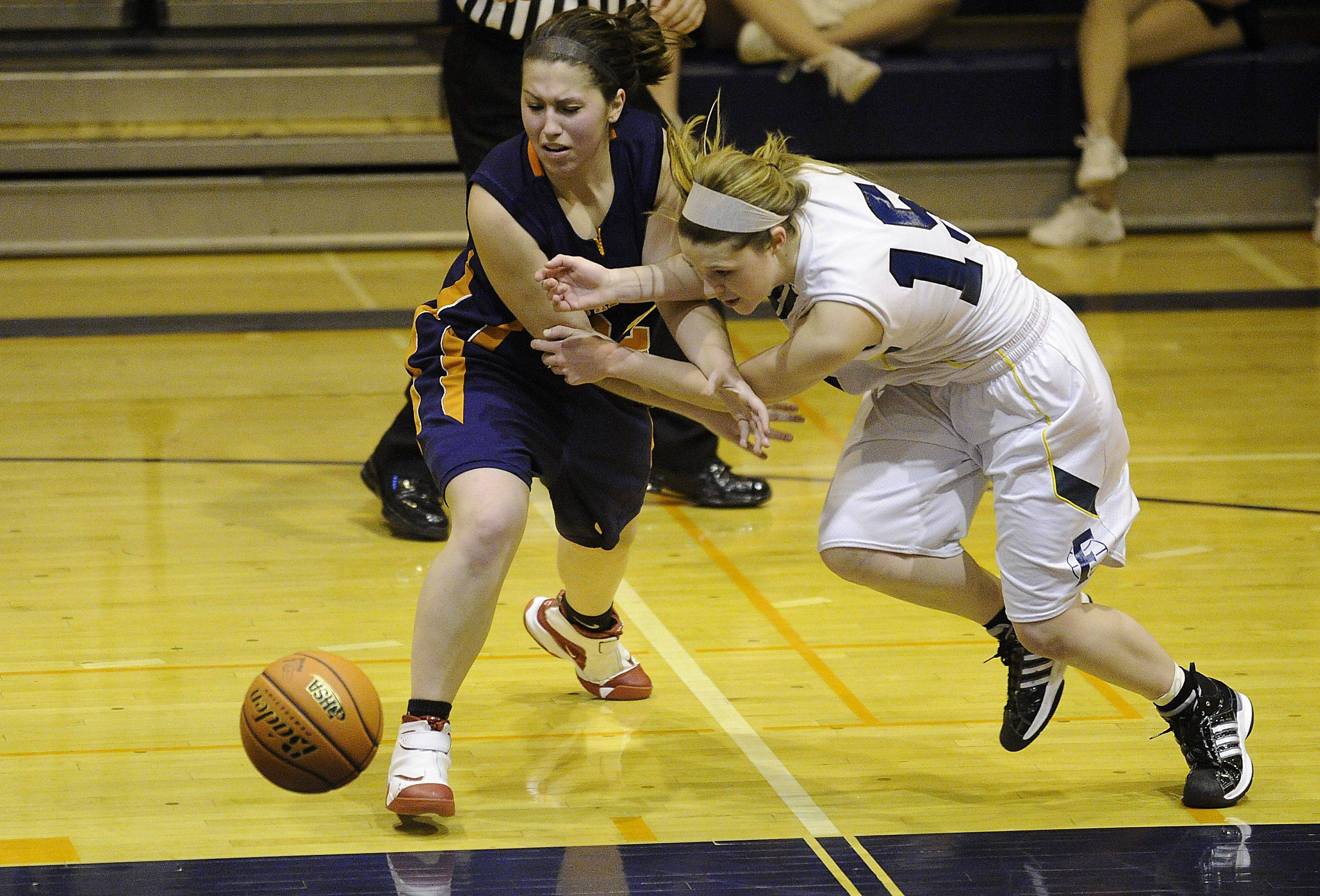 Fremd's Jaimie Groot and Buffalo Grove's Emily Georgoulis fight their way towards a loose ball in the second half.
