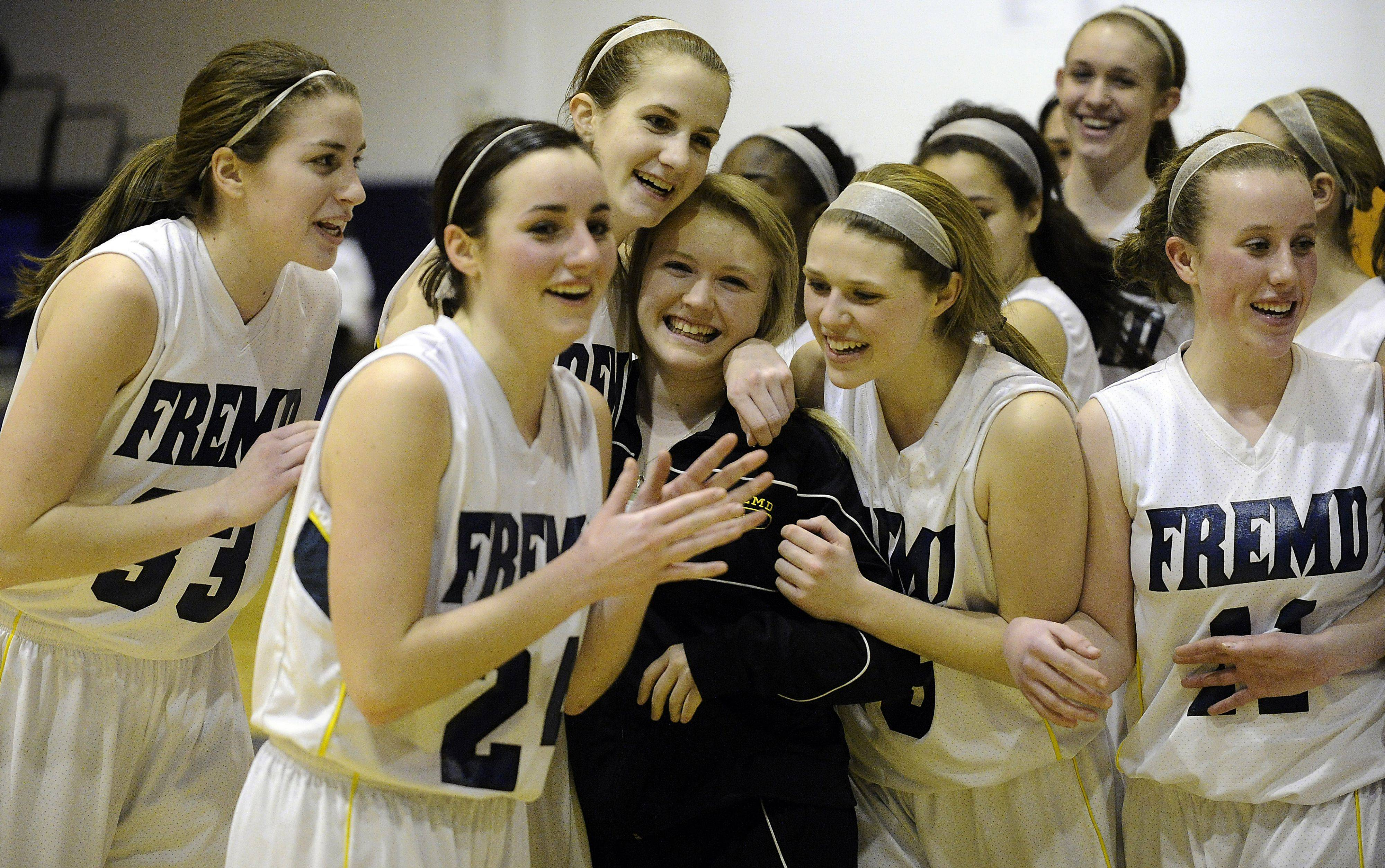 Fremd girls celebrate their victory over Buffalo Grove after the girls basketball regional championship game.