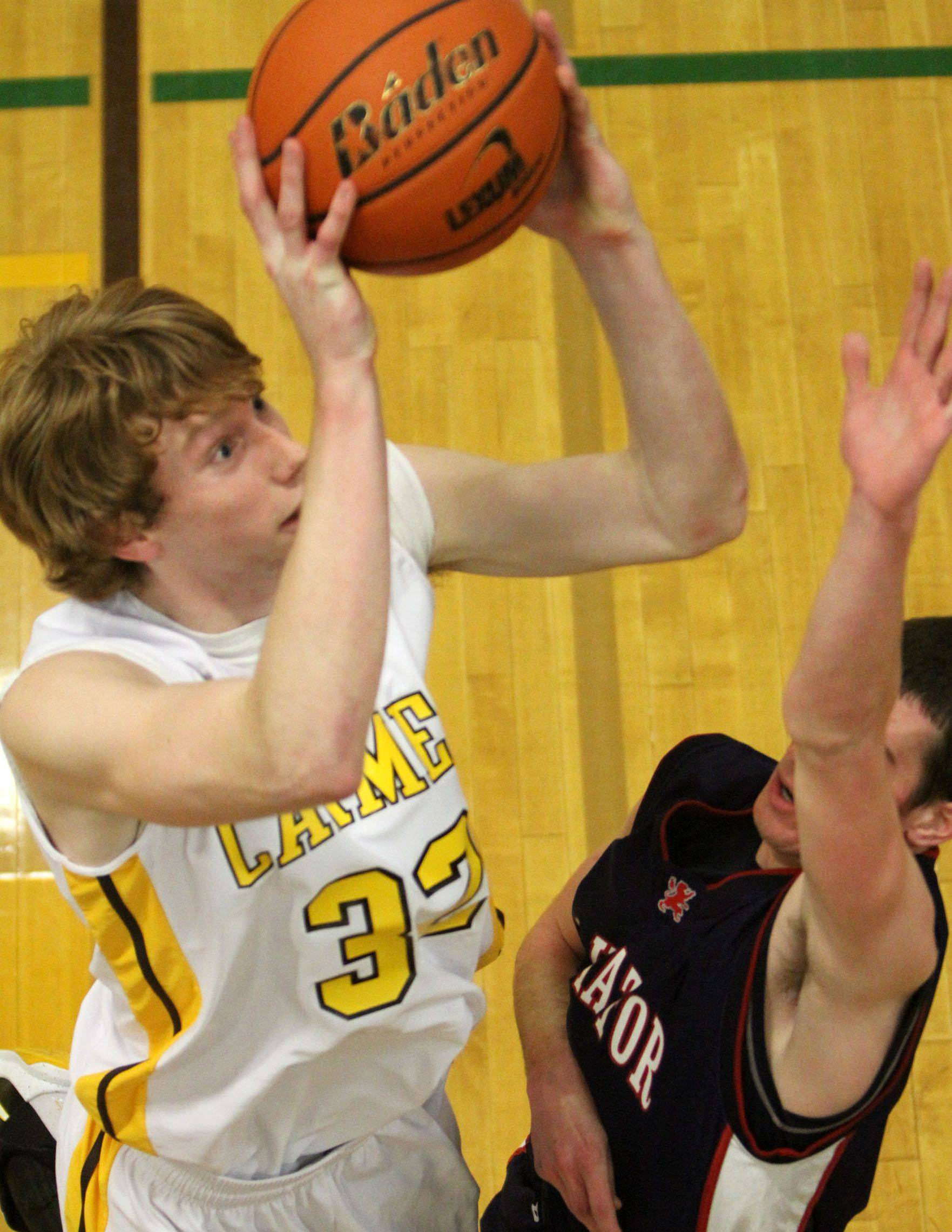 Carmel's Brandon Motzel shoots from under the basket against Danny Forde.