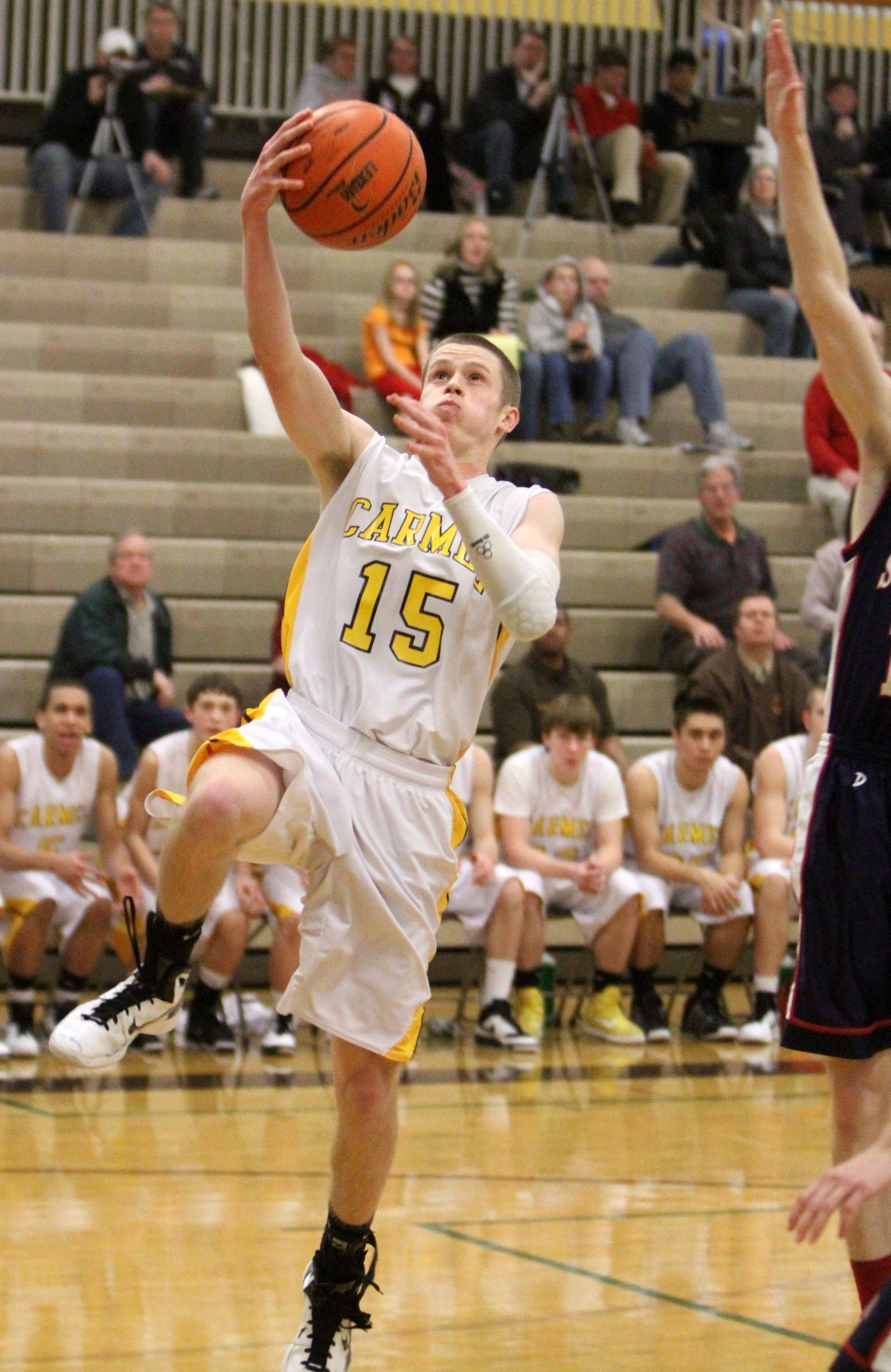 Carmel's Tim Hendricks shoot while driving to the basket against St. Viator at Carmel on Friday.