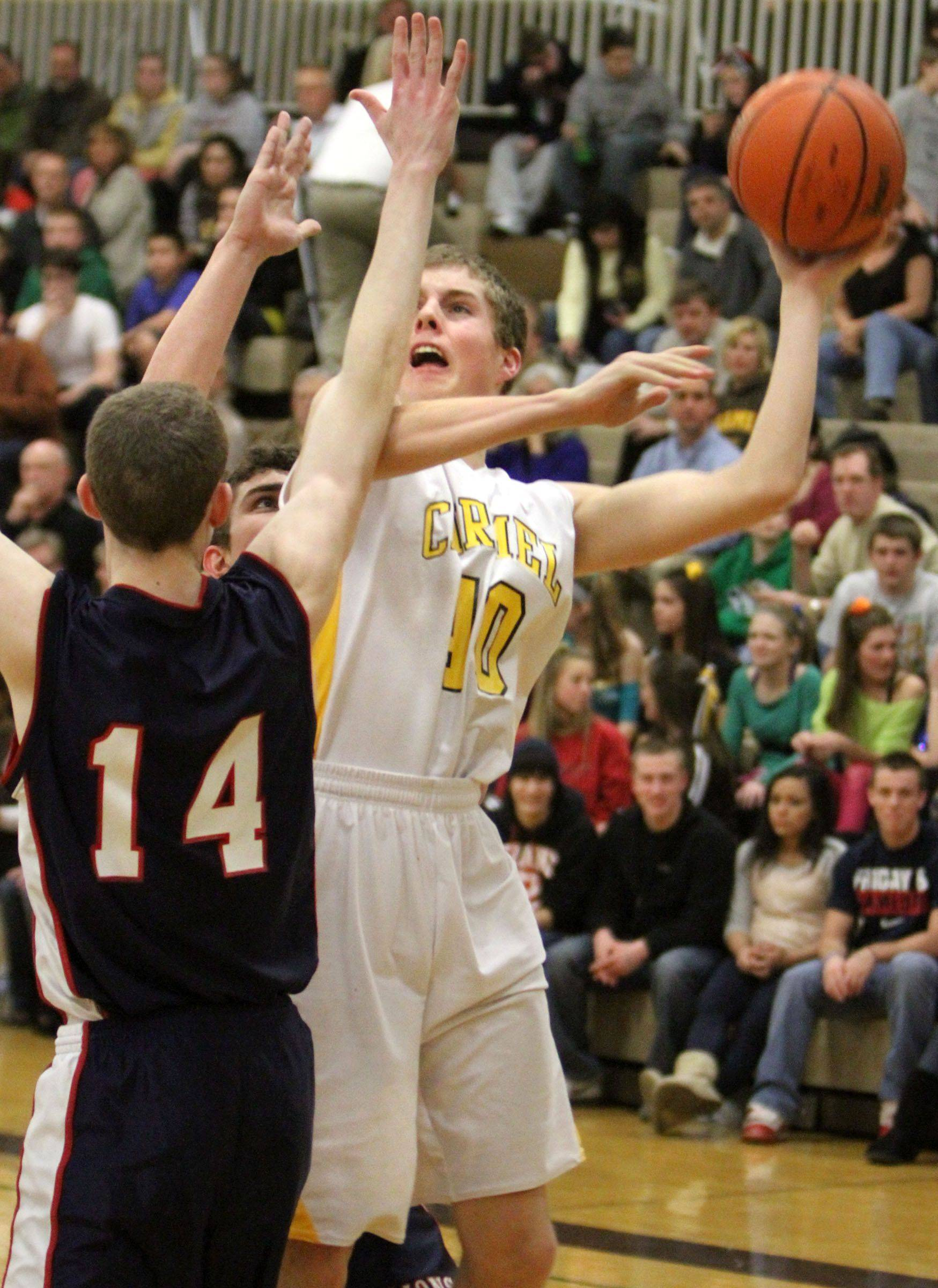 Carmel's Michael Fitzgibbons shoots over St. Viator's Kevin Walsh .