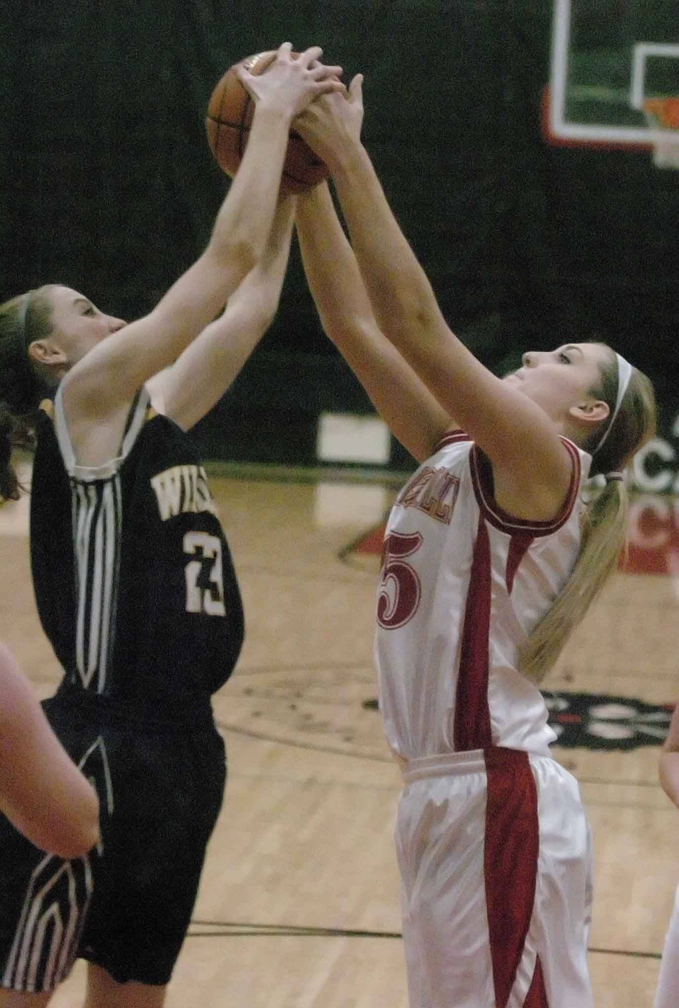 Allison Hendrick of Neuqua Valley ,left, and Victoria Towbridge of Naperville Central go up for a rebound.