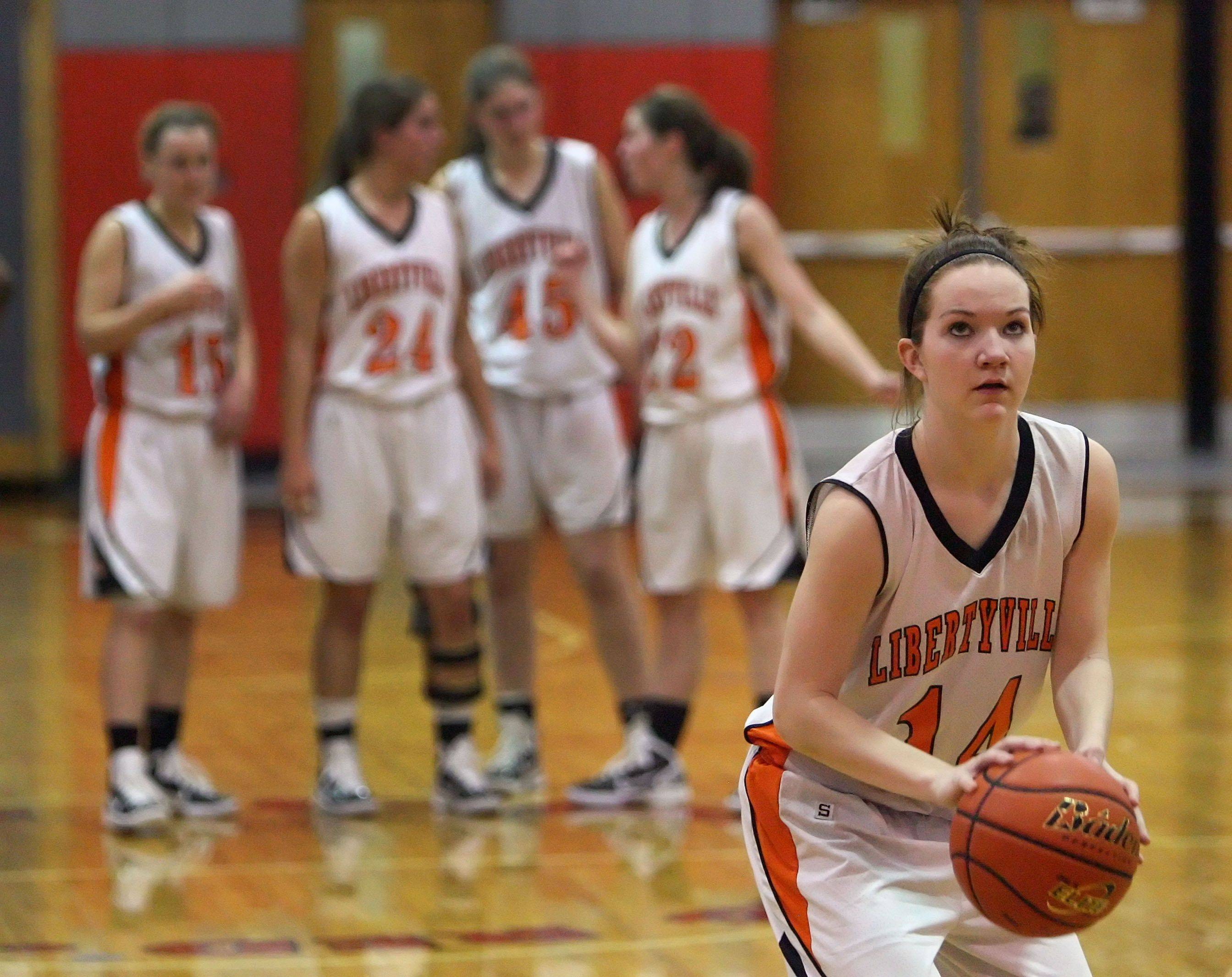 Libertyville's Savannah Trees shoots a free-throw after a technical foul was called .