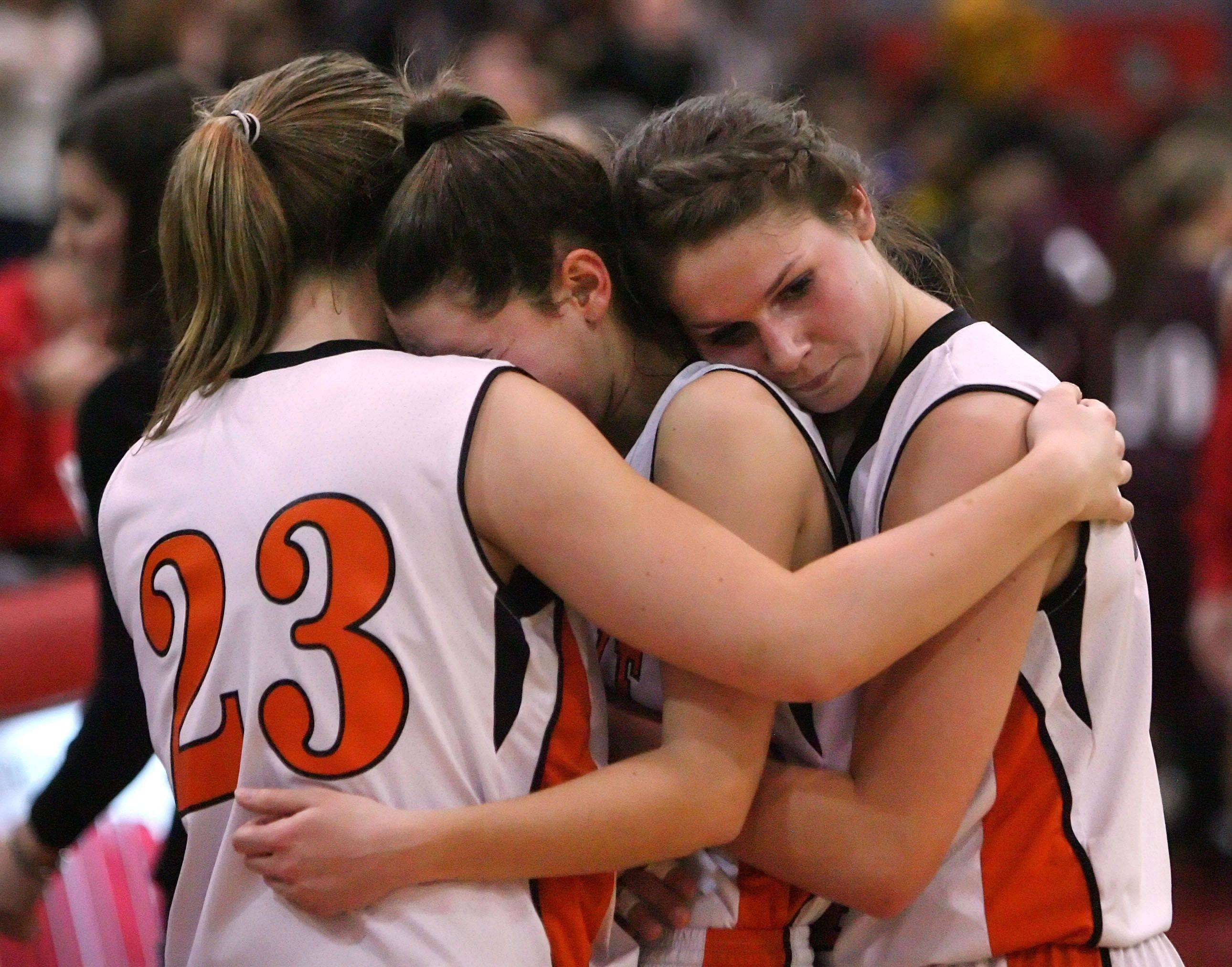 Libertyville girls from left, Molly Moon, Valerie Van Roeyen and Kaca Savatic embrace after losing to Zion-Benton.