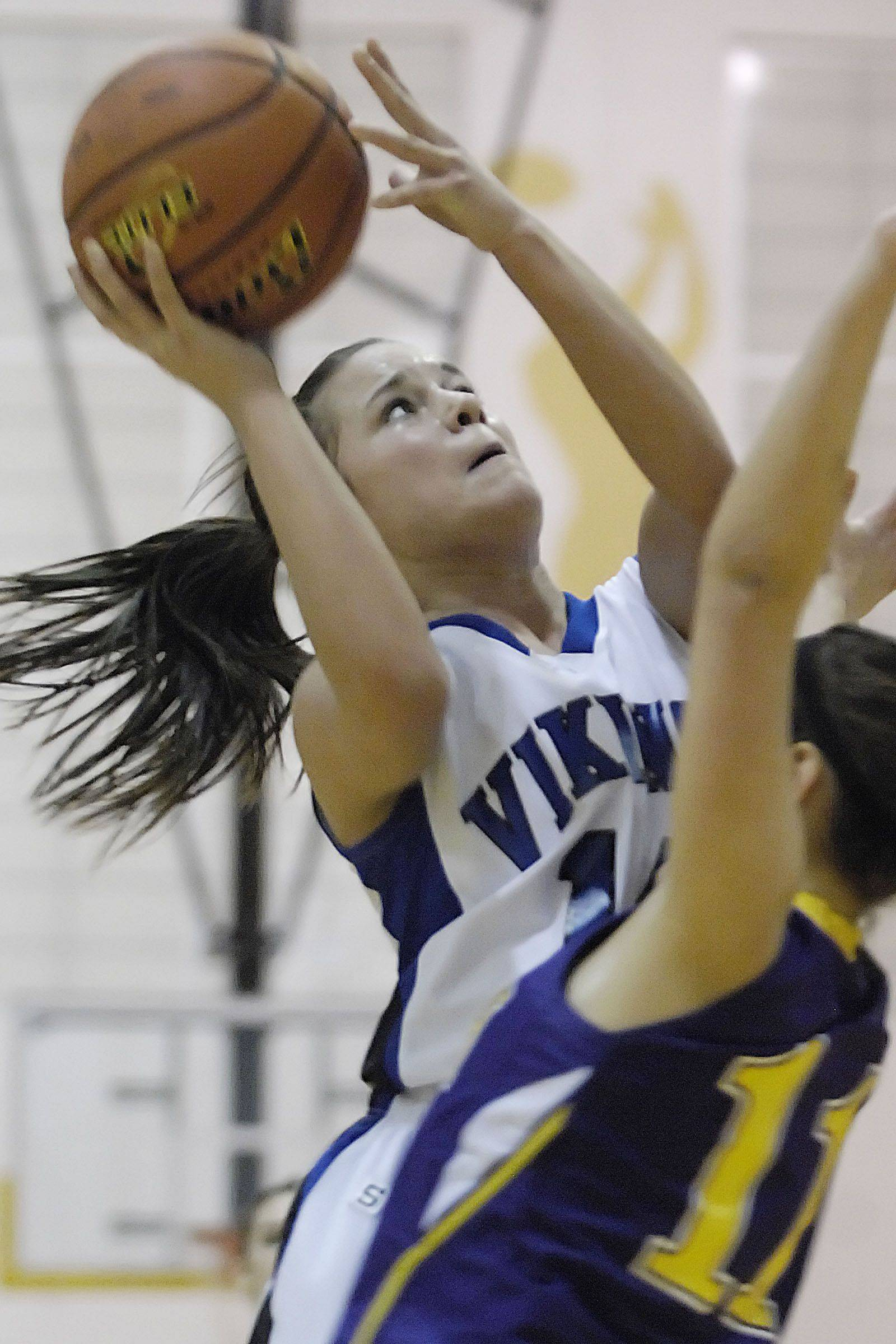 Geneva's Kat Yelle scores over Hononegah's Meg Macy Tuesday in the sectional semi final game in Algonquin.