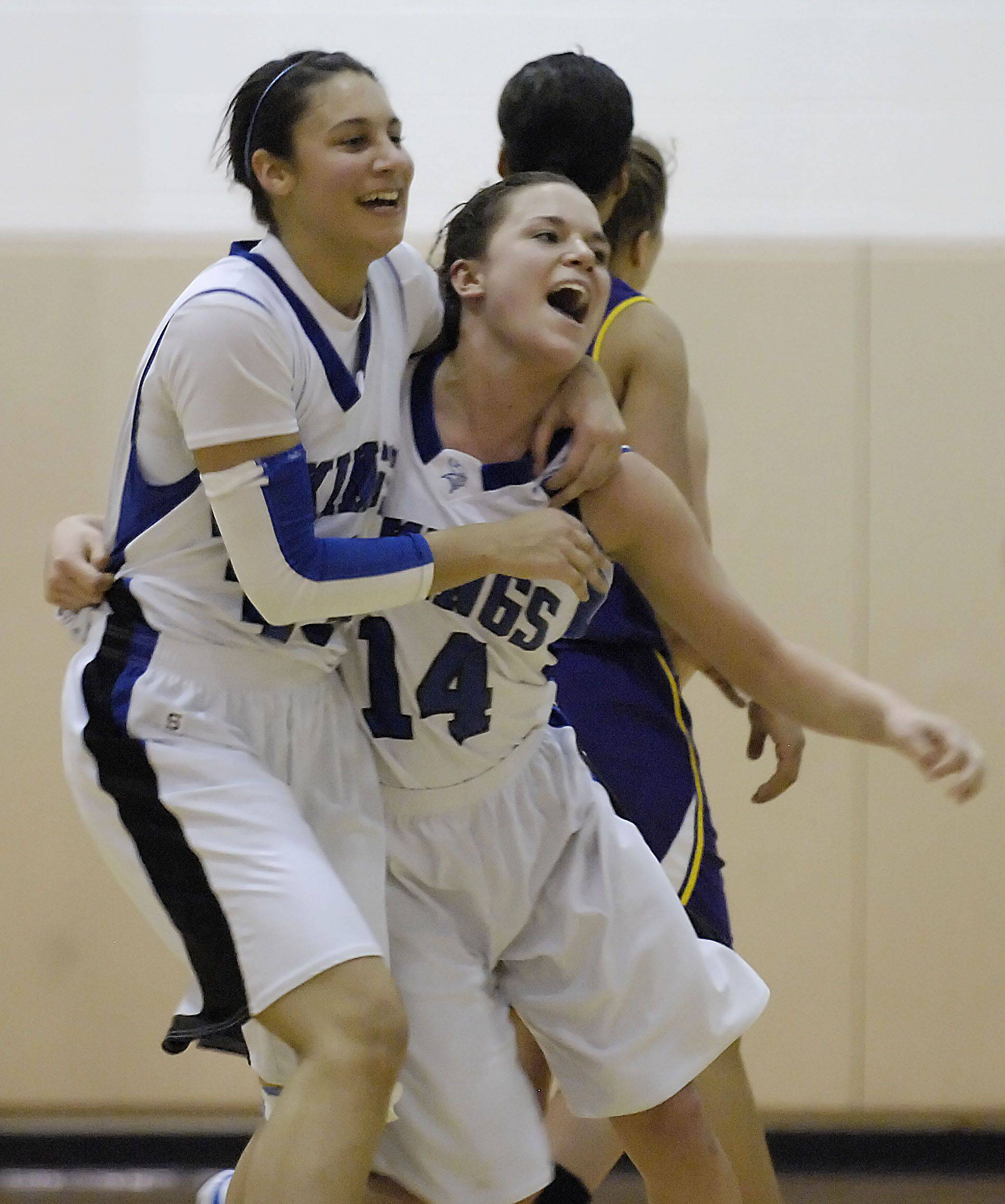 Geneva's Ashley Santos and Kat Yelle laugh after beating Hononegah Tuesday in the sectional semi final game in Algonquin.