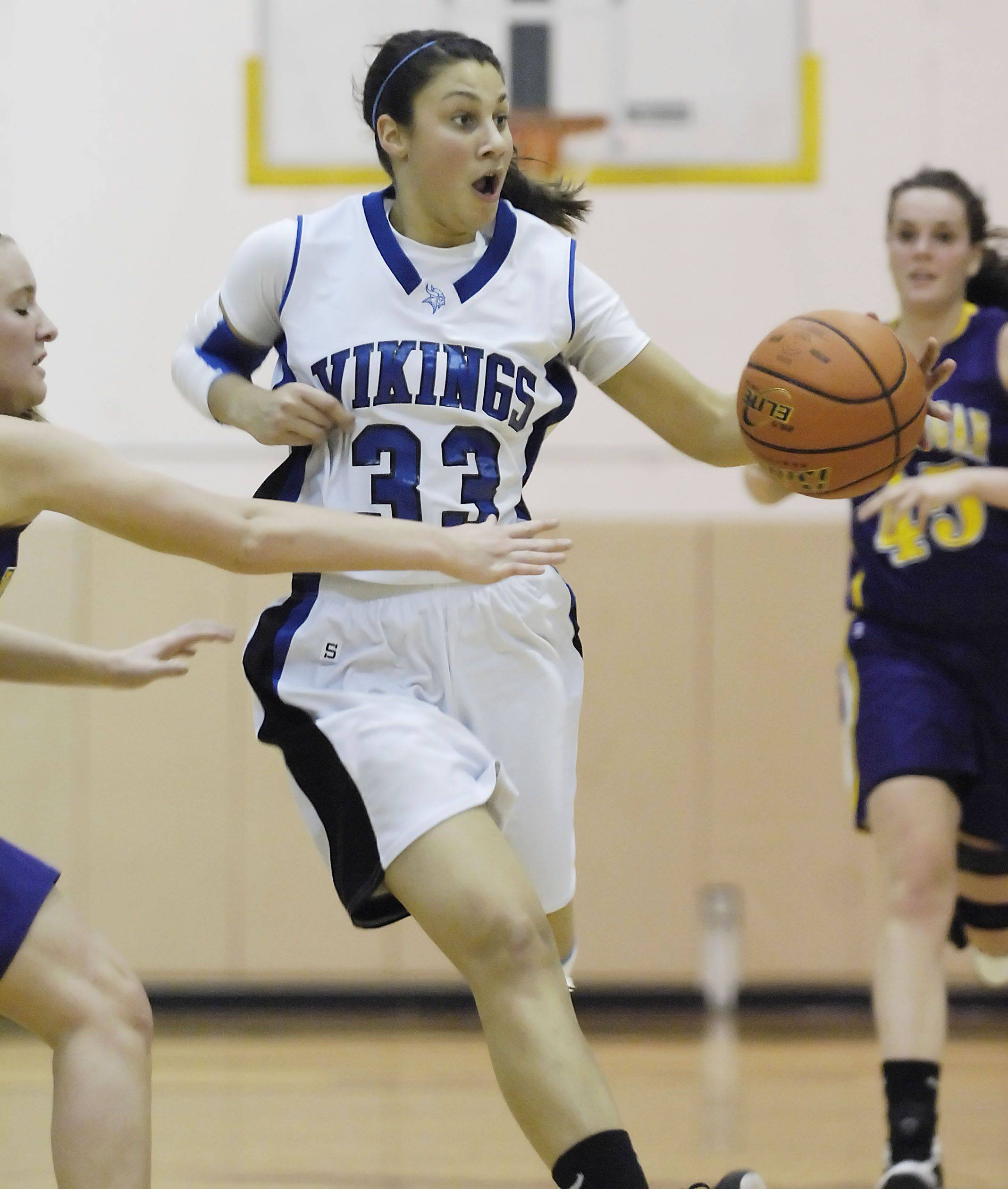Geneva's Ashley Santos pushes the ball up court against Hononegah Tuesday in the sectional semi final game in Algonquin.