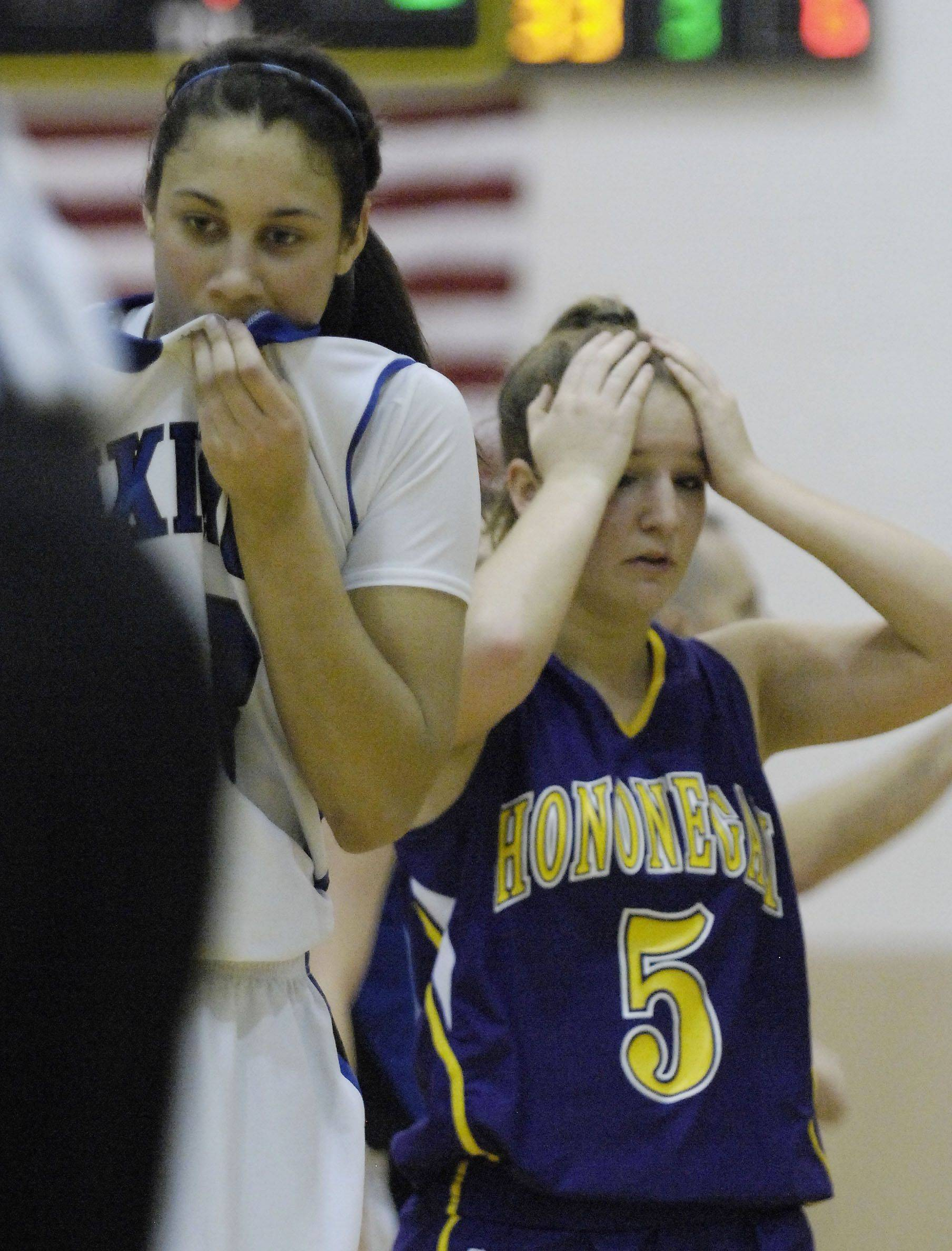 Geneva's Ashley Santos and Hononegah's Lindsay Carroll react after Carroll fouled Santos with her team down by 10 and 33 seconds on the clock Tuesday in the sectional semi final game in Algonquin.