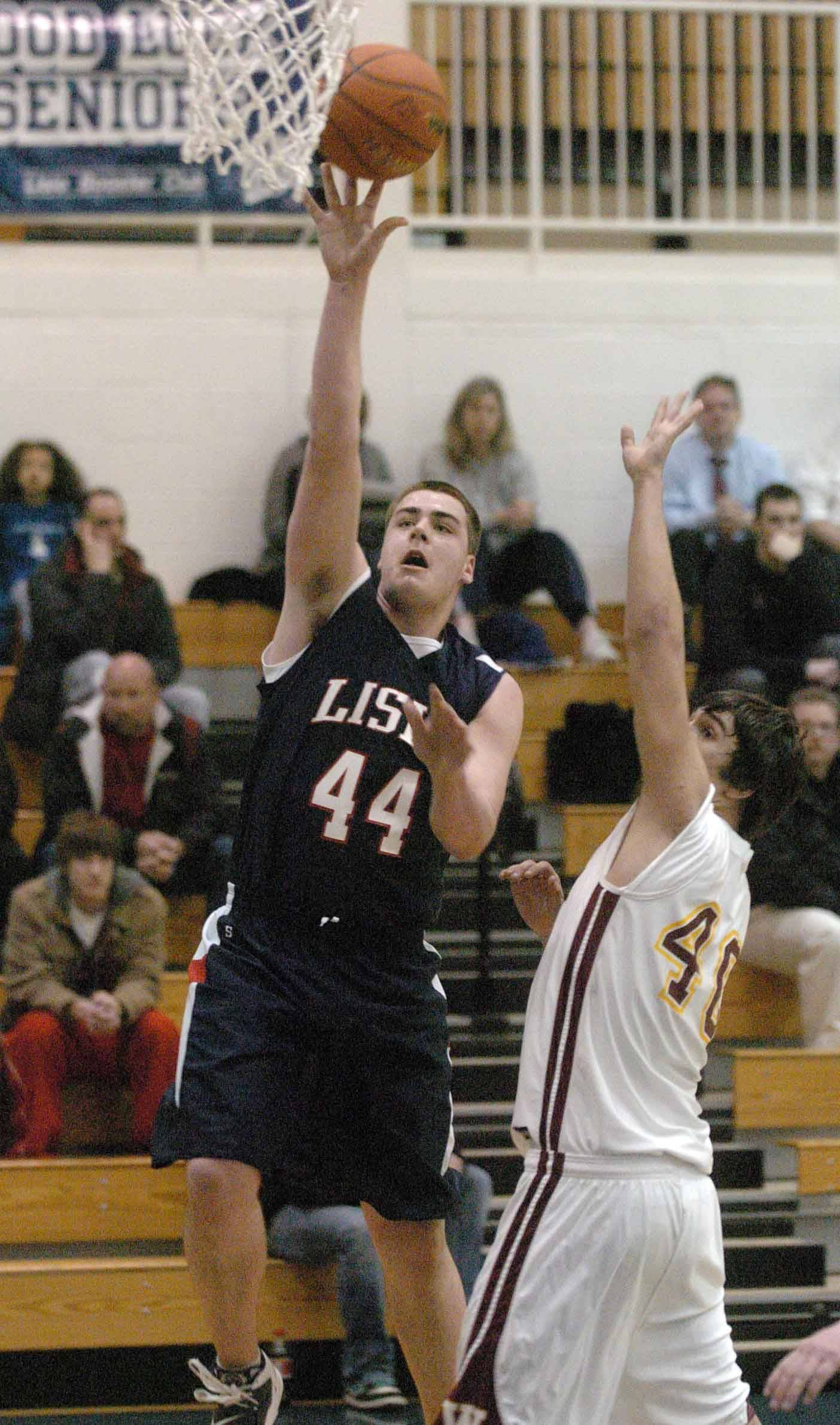 Phil Palicka of Lisle puts up a shot during the Westmont at Lisle boys Class 2A regional at Lisle HighSchool Wednesday.