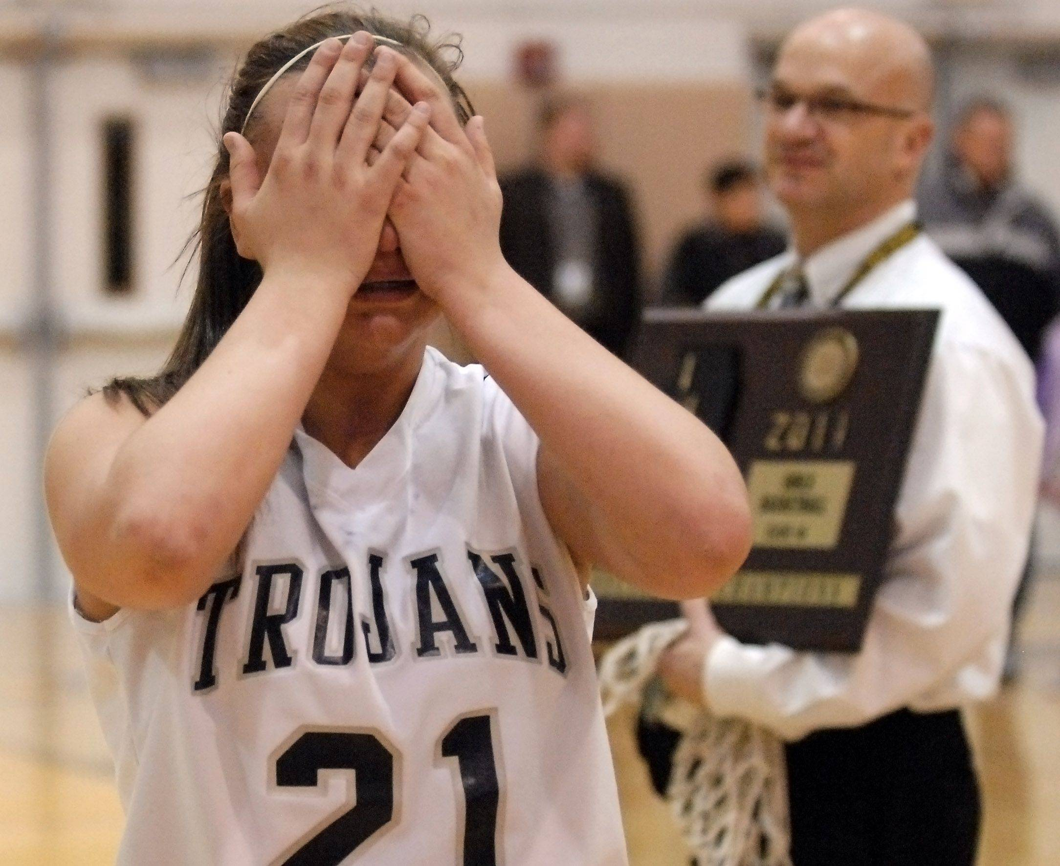 Cary-Grove's Megan Straumann is inconsolable after the Trojans' loss to Geneva.