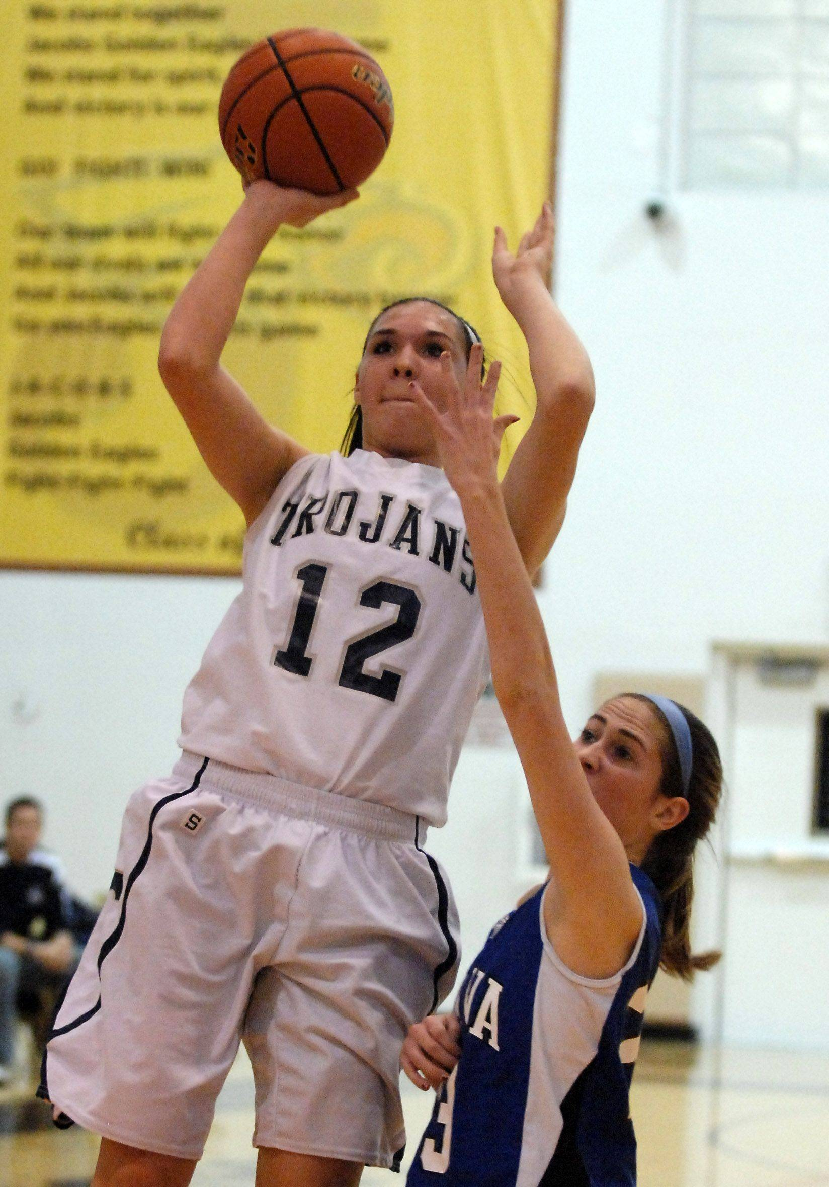 Cary-Grove's Joslyn Nicholson puts up a shot while being defended by Geneva's Katelyn Allen.