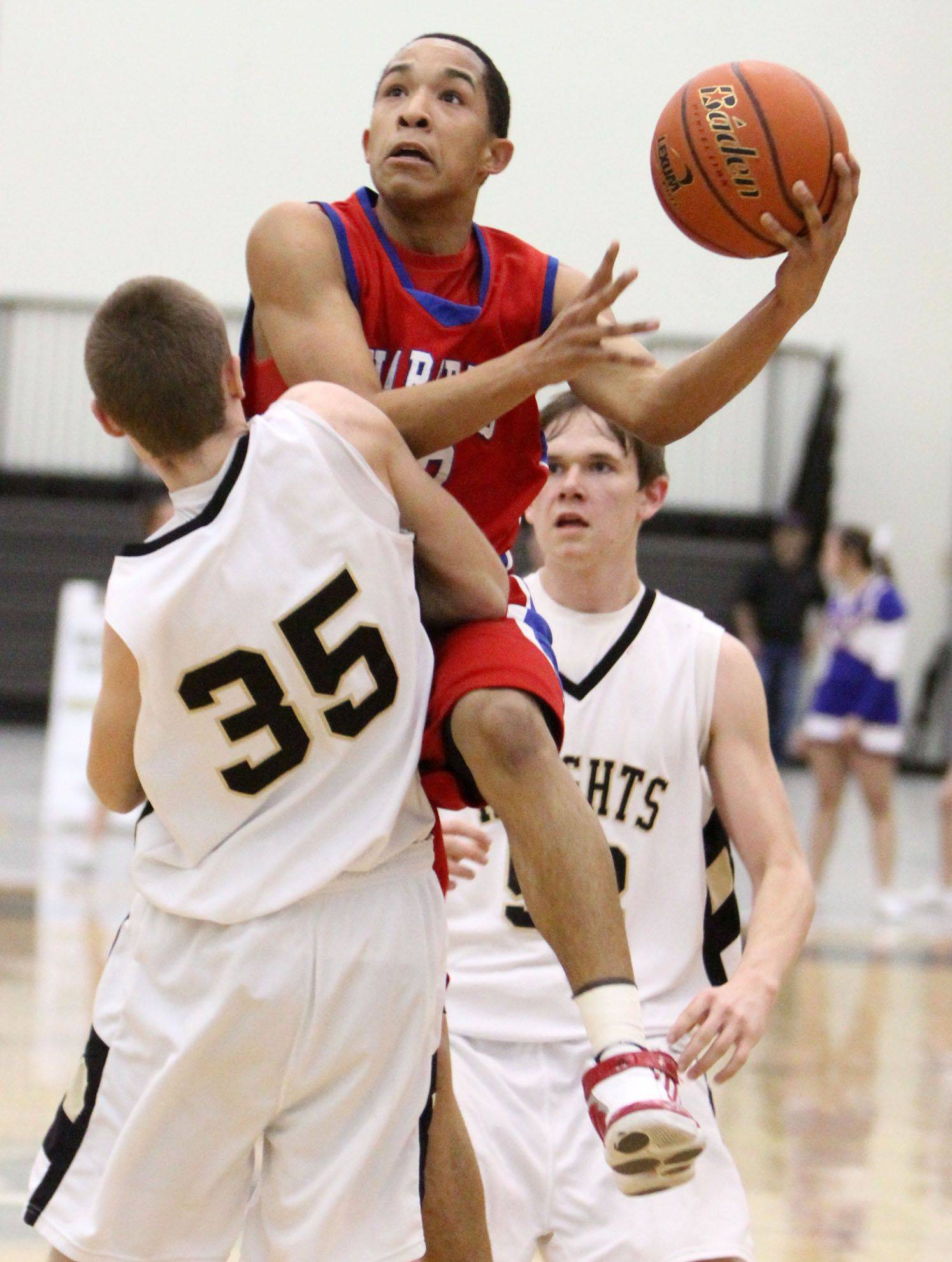 Dundee-Crown's Brandon Rodriguez drives to the basket against Grayslake North's Zack Krupp.