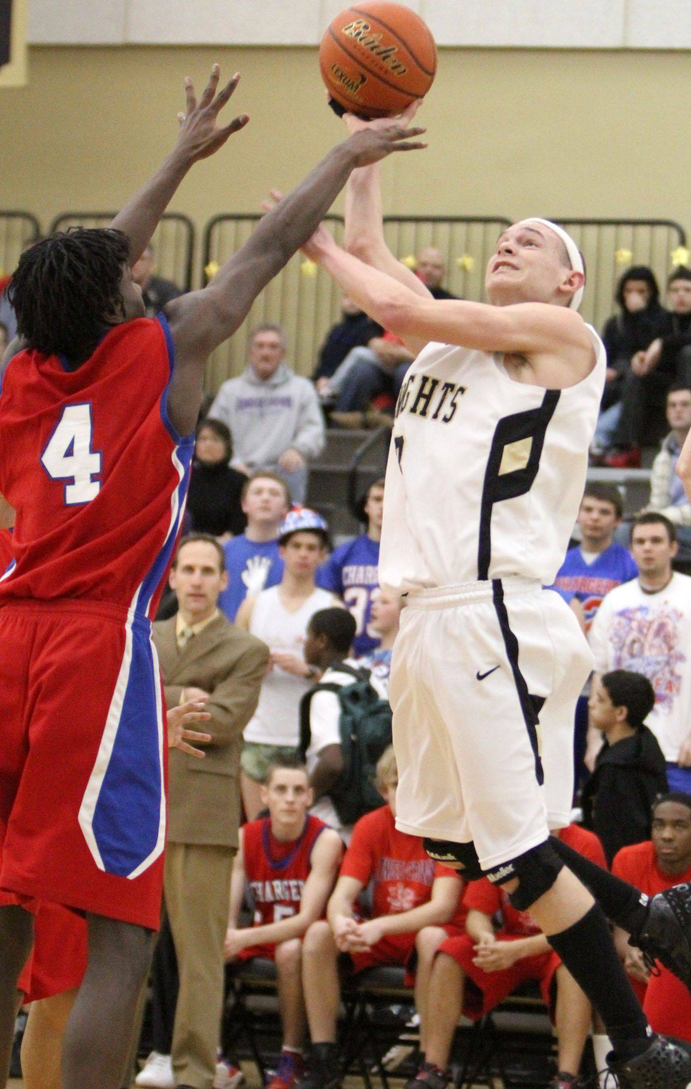 Grayslake North's Teddy Ludwick shoots against Dundee-Crown's Jamel Kimbrough.