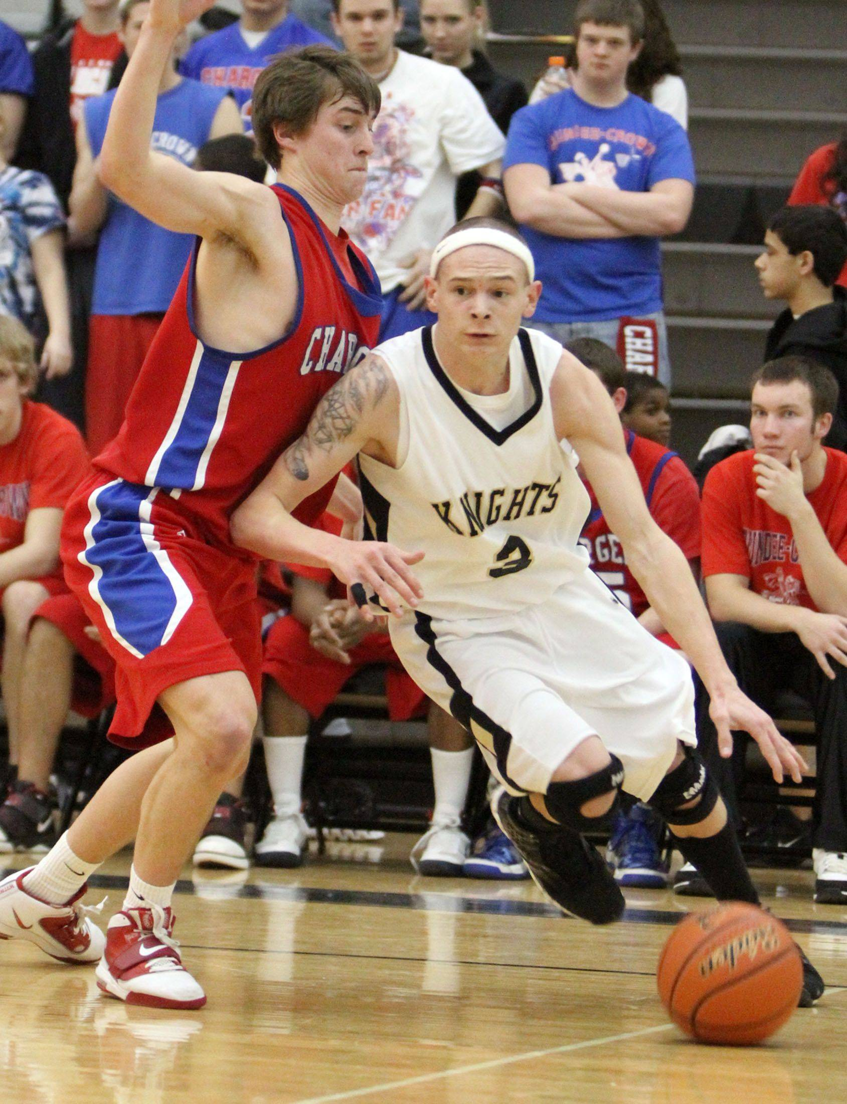 Grayslake North's Teddy Ludwick turns the corner on Dundee-Crown's Kevin Cronin.