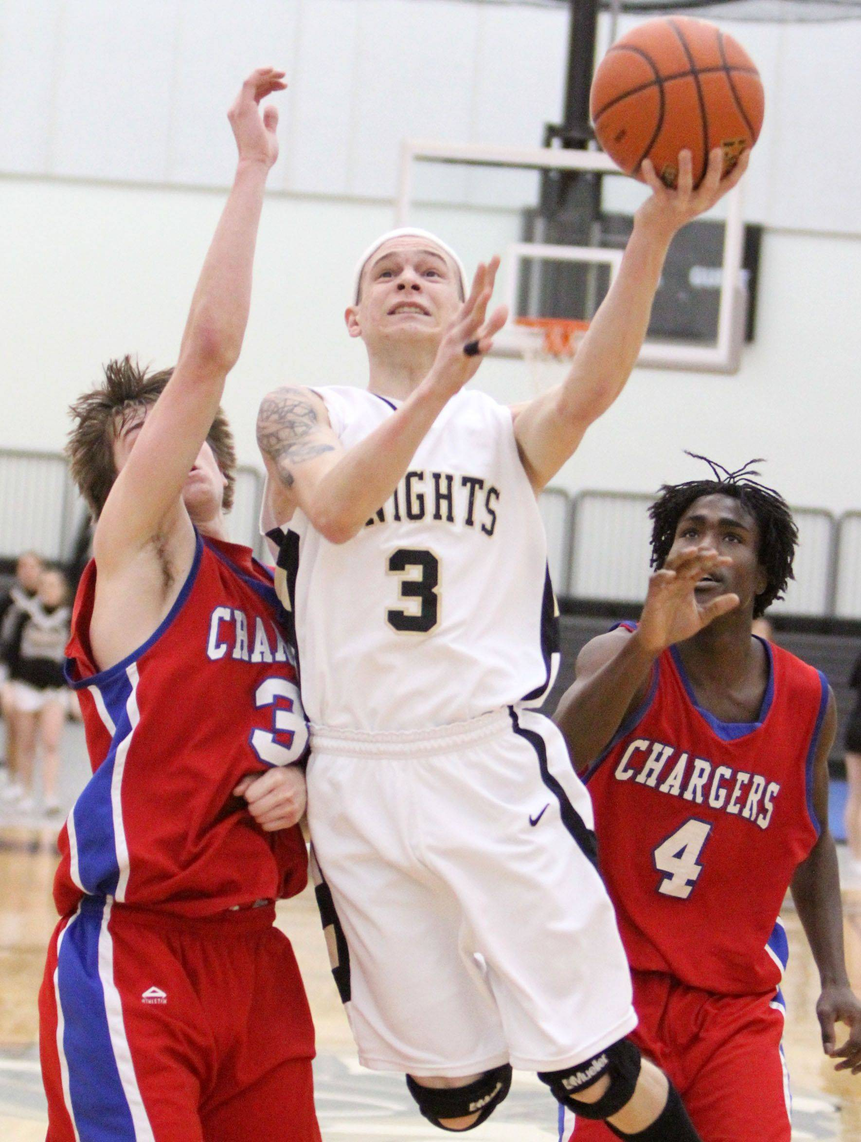 Grayslake North's Teddy Ludwick shoots against Dundee-Crown's Kevin Cronin.