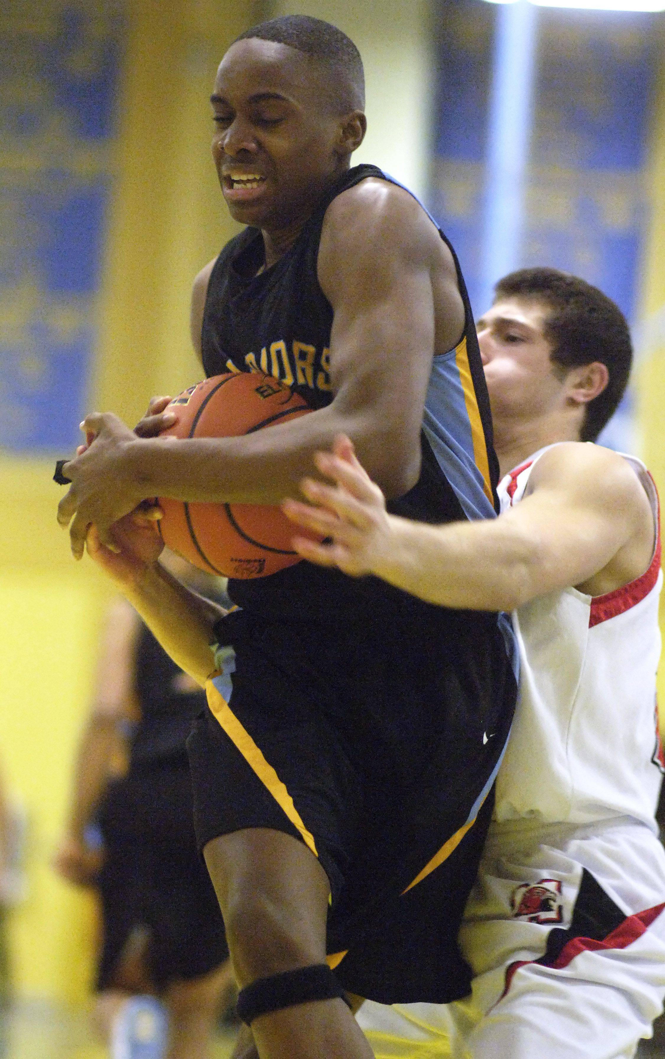 Maine West's Odera Eneogwe, left, grabs a rebound in front of Maine South's Matt Alviti during Tuesday's regional semifinal.