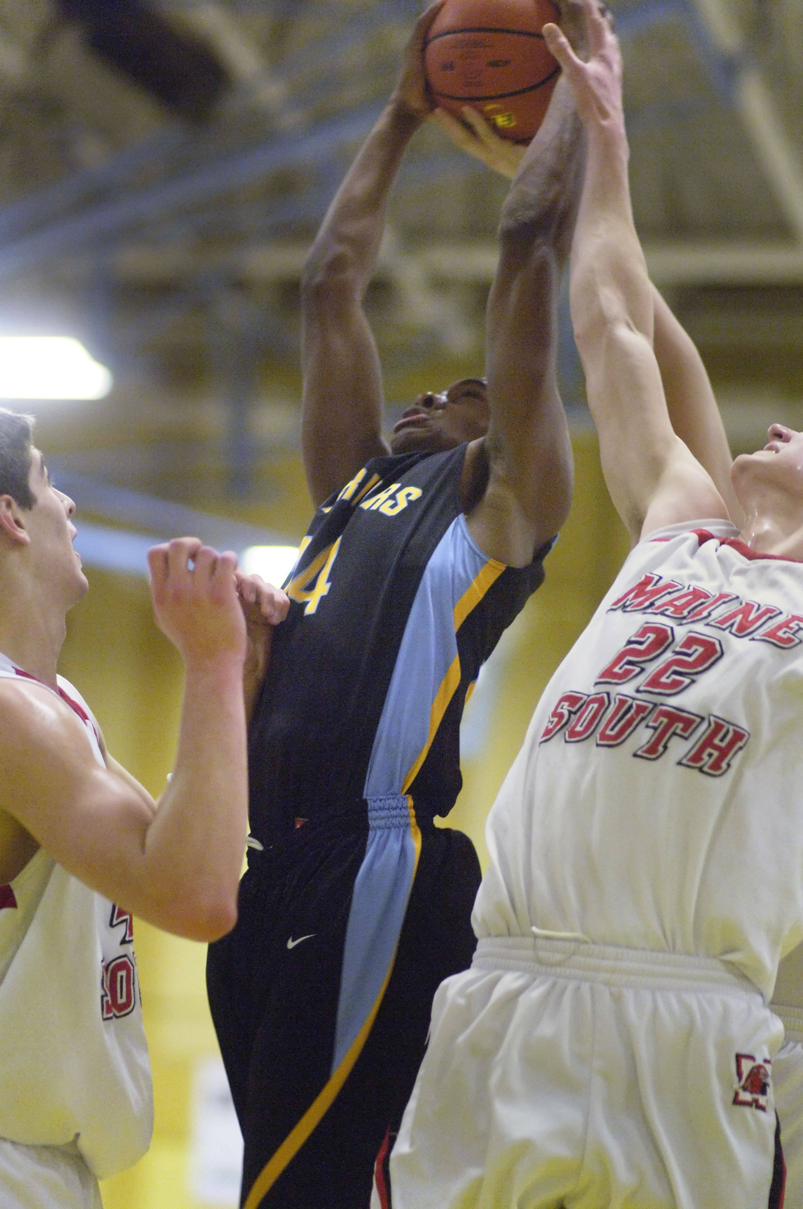 Images from the Maine West vs Maine South boys regional basketball game in Des Plaines on Tuesday, March 1st.