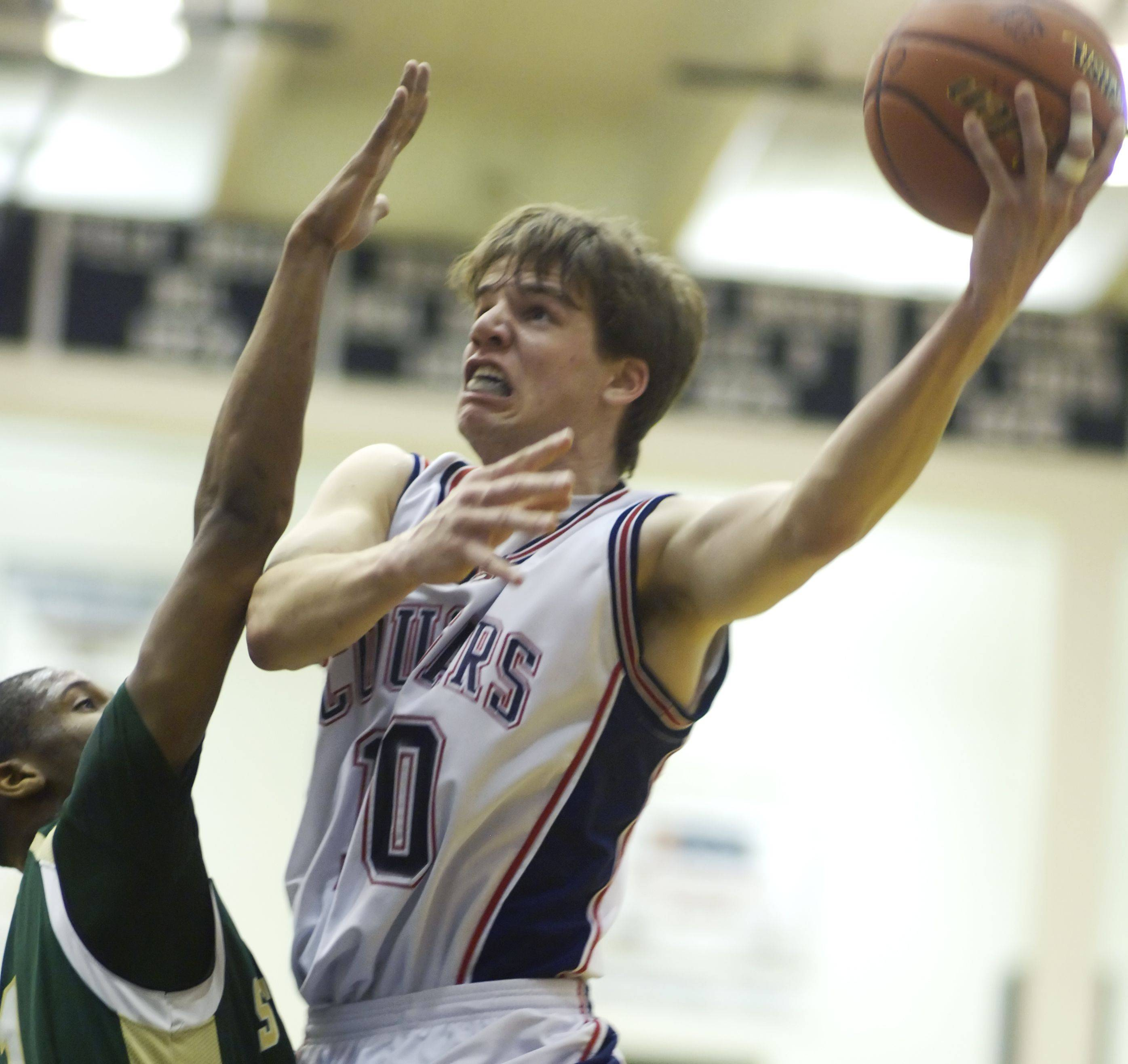 Conant's Brian Wadsworth, right, makes a strong move to the basket against St. Patrick's Royale Ewing.