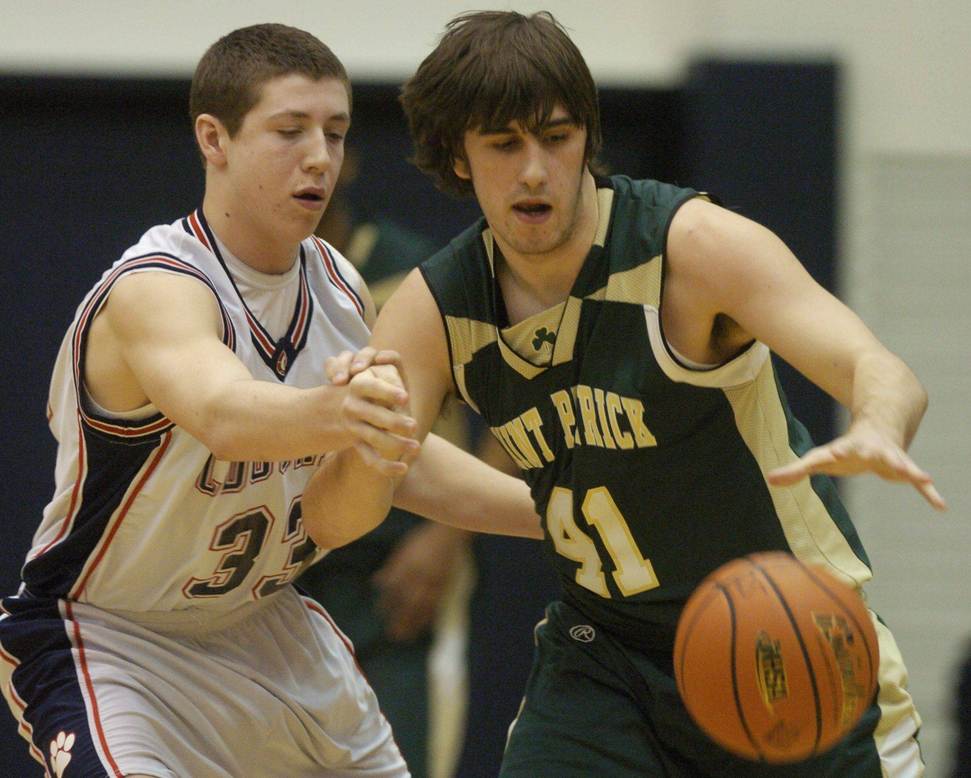 Conant's Tim Manczko, left, tries to take the ball from St. Patrick's Dan Caplis Wednesday.